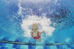 Child jump deep down underwater