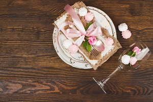 Tableware and silverware with puffy light pink roses