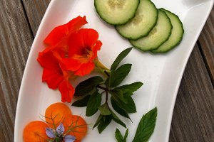 Vegetables and edible flowers on try