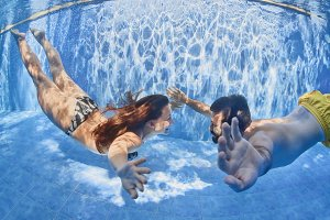 Happy couple have a fun in pool