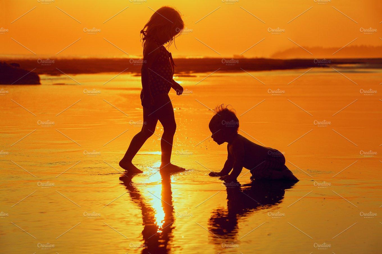 Children on sunset beach ~ People Photos ~ Creative Market