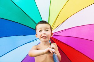 Funny child with colorful umbrella