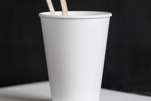 Disposable cup on the wooden table