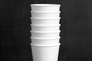 Disposable cups on the wooden table