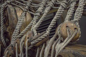 old ship rope on a wooden sailing ship close up