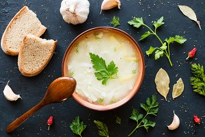 soup with noodles, herbs and spices