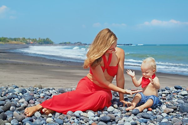 Mother with son on the beach