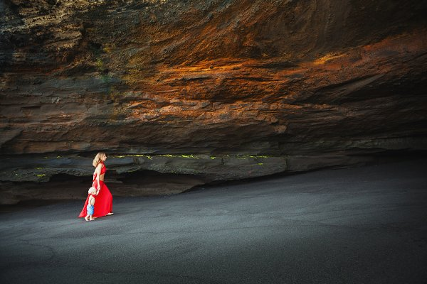 Mother with son in sea beach grotto