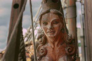 statue of a woman in the ship's bow