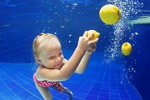 Child has a fun in swimming pool