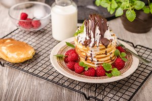 American pancakes with icecream and chocolate