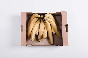 Bunch of bananas in a cardboard box