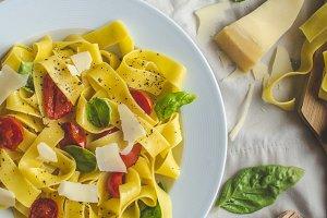 Tagliatelle in Italian colors, roasted tomatoes, basil Tagliatelle