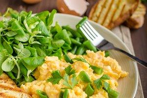 Scrambled eggs with salad