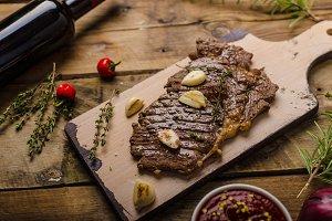 Rib eye steak with wine