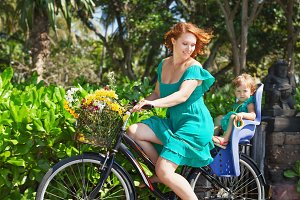 Mother with child on bicycle