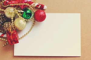 Blank paper and Christmas ornament