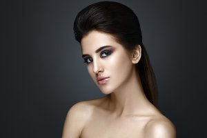 Beautiful woman with evening make-up and updo