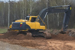 Reconstruction of the highway - yellow excavator at work