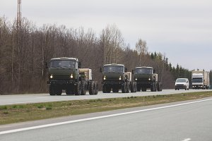 Three military truck on the road - Russian army