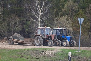 Two tractors at countryside - machinery for agriculture