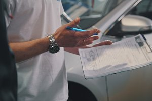 Master and worker checking car - garage auto service - small business