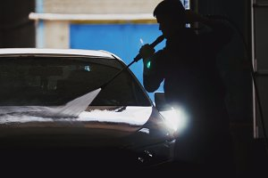Car washing in workshop - silhouette