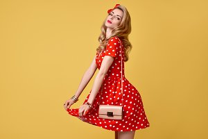 Fashion PinUp Girl in Red Polka Dots Dress.Vintage