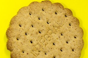 Round whole-grain crackers on colored background