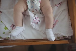 Baby lying in crib at home