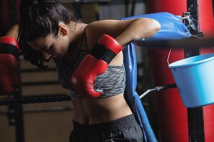Female boxer taking a break after a practice