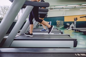 People legs running over treadmill in training session