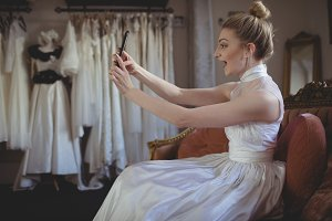Young bride taking a selfie