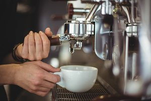 Waitress preparing a cup of coffee
