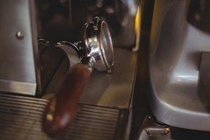Close-up of portafilter on espresso machine