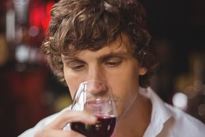 Man having a glass of red wine