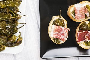 Fried green peppers and ham slices with peppers. Spanish gastronomy. Food.
