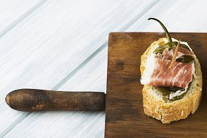 Spanish tapas of ham and green pepper on wooden board. Spanish gastronomy. Food.