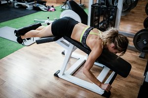 Woman performing exercise on bench press