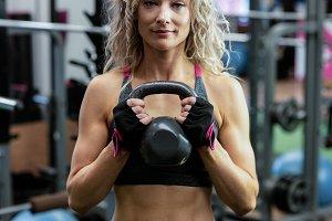 Beautiful woman lifting kettlebell