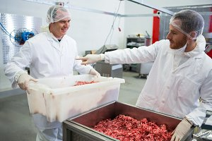 Butchers interacting with each other