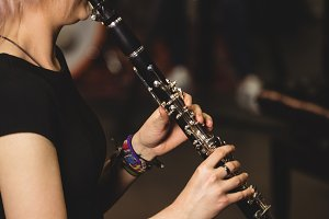 Female student playing clarinet