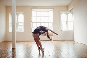 Young woman practising hip hop dance
