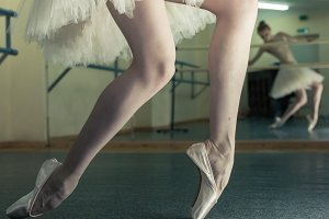 Long legs of ballerina in toeshoe