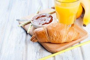 Healthy breakfast croissant, jam