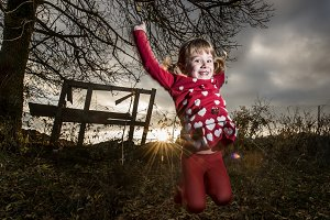 Little girl playing, running and enjoying in the forest