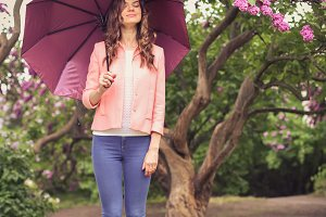 Girl with umbrella in park