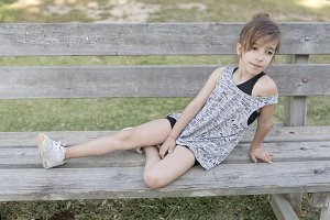 Girl sitting on a wooden