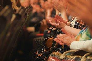 Women applaud at a concert