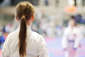 Young karate girl in karate competitions